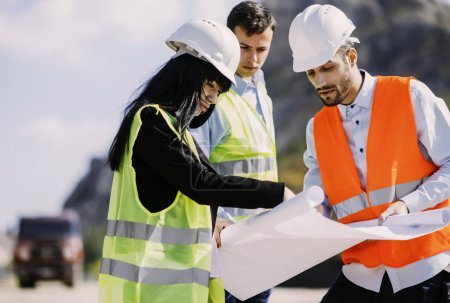 Engineers on construction site. Construction concept