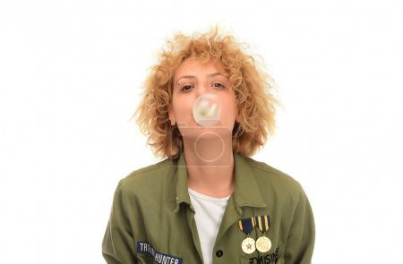Attractive blonde woman making balloon with bubble gum