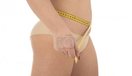 overweight woman with measuring tape isolated on white background
