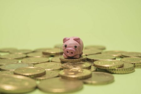 Savings concept. Micro Piggy Bank and euro coins Money concept.