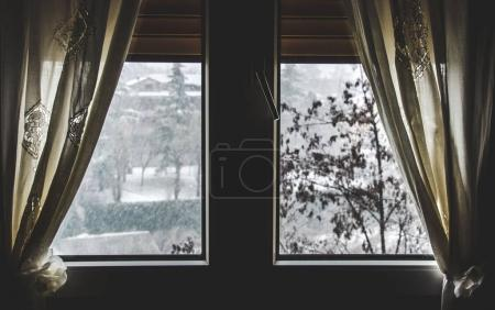 thermal insulation window save energy bills snow fall view winter dark window curtain stay home snowing outside