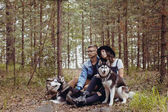 Young couple with dogs in forest