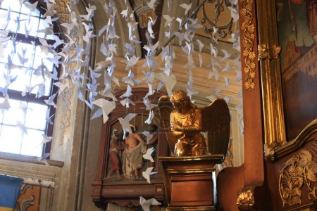 Interior of the Jesuit church of St. Peter and Paul with paper birds in Lviv, Ukraine