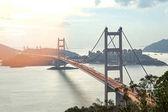 silhouette Tsing Ma double-decked suspension bridge between Ma Wan island and Tsing Yi island in Hong Kong