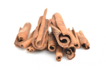 Cinnamon sticks putting on white background
