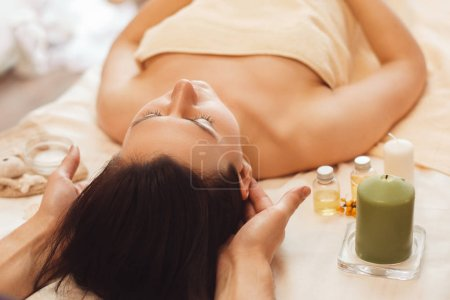 Woman with migraine relaxing at salon free space