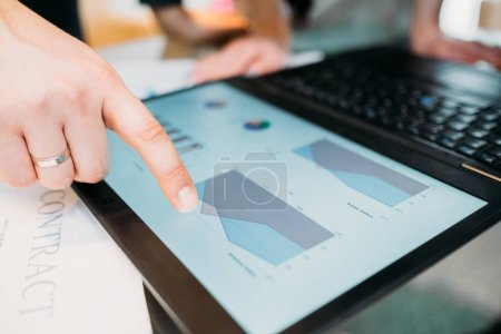 Photo for Business documents review. man pointing at some important data laptop with a finger. statistics papers analysis. investment rates discussion - Royalty Free Image
