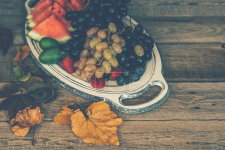 Photo for Vintage tray with autumn fruits on rustic vintage table top view. Fresh organic fruits. Food background. Healthy food. Top view. Toned image. - Royalty Free Image