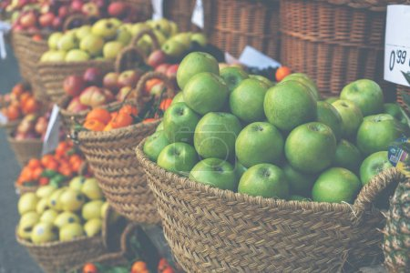 Photo for Raw organic autumn farmers market box with raw fresh vegetables. Fresh organic produce on sale at the local farmers market. Ripe organic apples in a basket. - Royalty Free Image