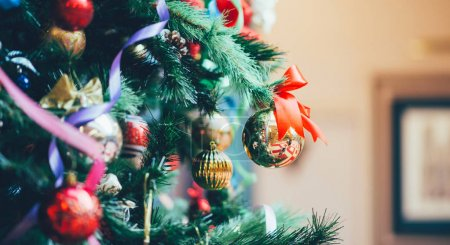 Photo for Christmas decorations with light behind it, creating a nice blurry boken. Christmas or new year still life with ornaments. Copy space for text. - Royalty Free Image
