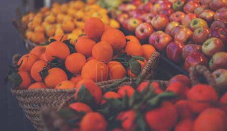 Photo for Fresh organic food at the local farmers market. Farmers markets are a traditional way of selling agricultural products. Fruits in basket. Bio, healthy food. Vegetarian food. - Royalty Free Image