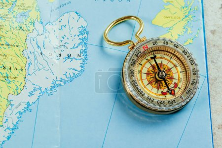 Compass lying on map