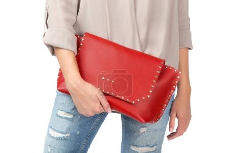 Woman holding a handbag isolated on white background