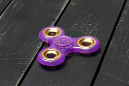 spinner on a wooden table, close up.