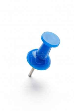 close up of a pushpin on white background