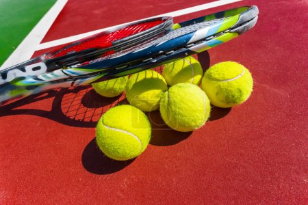 Tennis balls and rackets on the grass court
