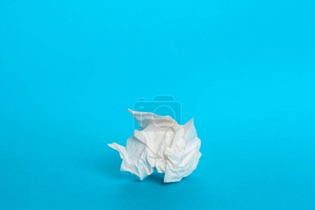 Piece paper napkin on blue background