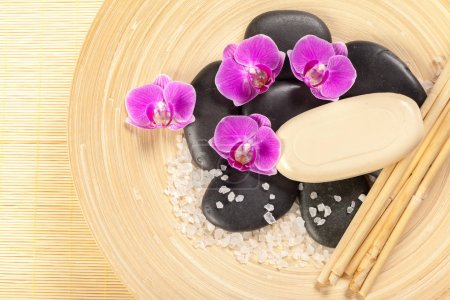 Composition with zen stones and orchid flowers