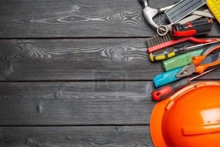Photo for Assorted work tools on wooden table - Royalty Free Image