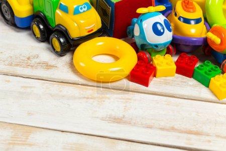 Set of children toys on wooden background