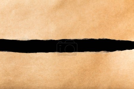 paper torn off on black background
