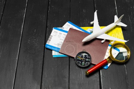 Travel objects on wooden background