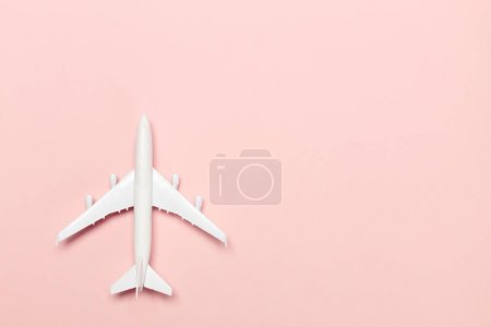 airplane toy on color background