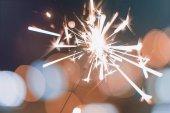 Night background with a sparkler. Sparkler  Bokeh