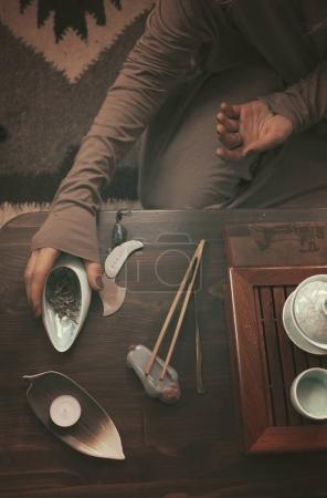 woman preparing for tea ceremony
