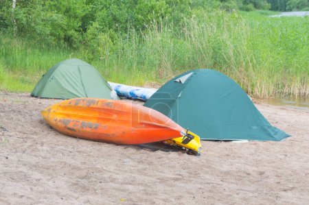 kayaks and camp on the shore of the lake.
