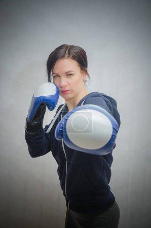 Slim, sporty girl in Boxing gloves...