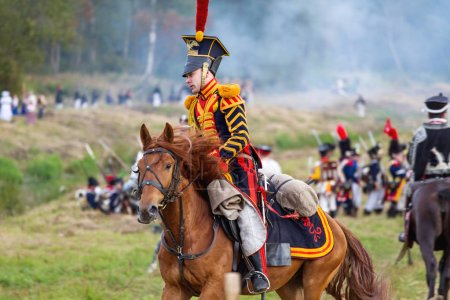 Photo for BORODINO, RUSSIA - September 02, 2017 - Reenactment of the battle of Borodino (the Patriotic war of 1812 year). Tourists watch the performance from from the fenced places. Moscow region, Russia. - Royalty Free Image
