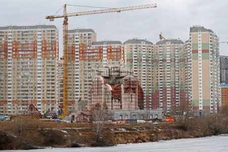 Nikolskaya church under construction on the background of residential buildings in Moscow