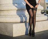 Woman  tightens nylon lace tights.
