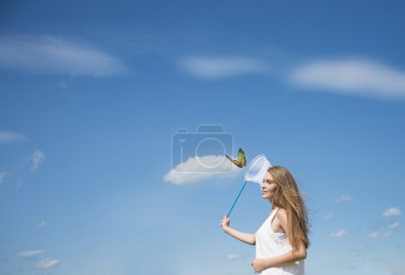 girl catching a butterfly