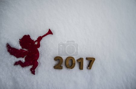 silhouette of angel, drawing on snow drift