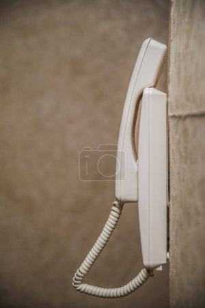 white plastic house intercom