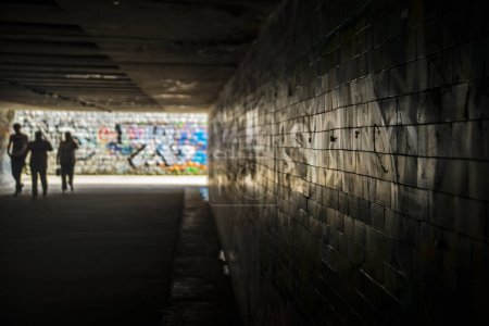 underground crossing with graffiti on walls