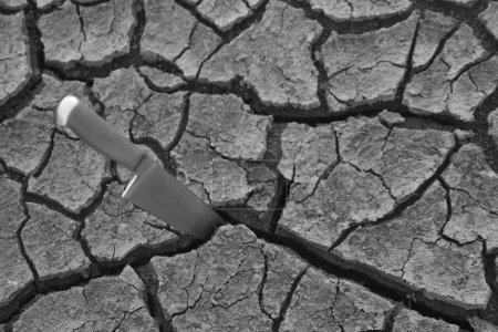 knife in Cracked dry ground