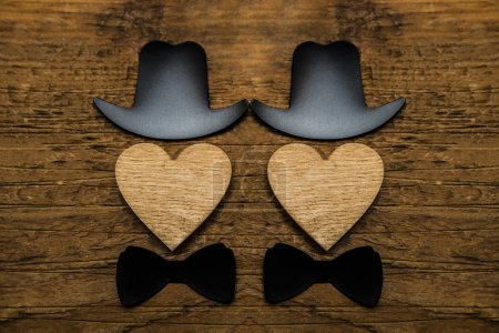 male personages with wooden hearts