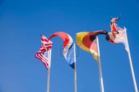 flags against blue clear sky background