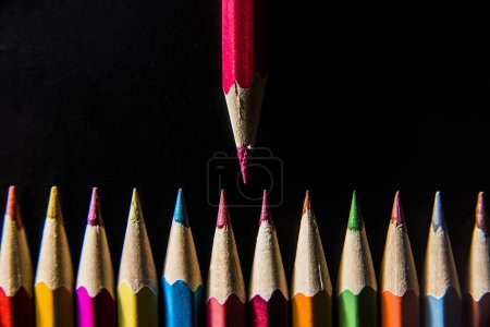 one  pencil standing out