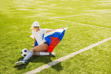 girl holding  in hands Russian flag