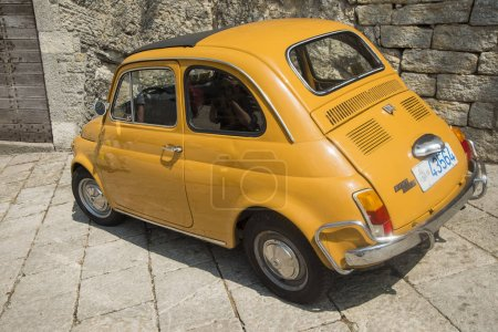 Yellow tiny retro car Fiat