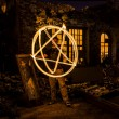 Pentagram made of fire. Man making  star from free...