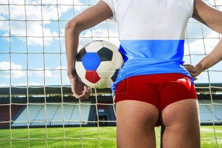 Goalkeeper woman holding ball