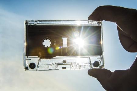hand holding  Magnetic tape cassette
