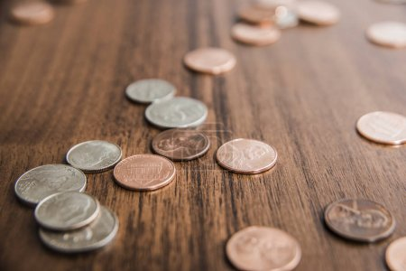 cents  on old wooden table backgroun