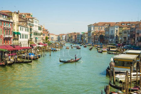 VENICE, ITALY - June 19, 2014: Grand Canal in Venice with ancient hoses,  gondolas