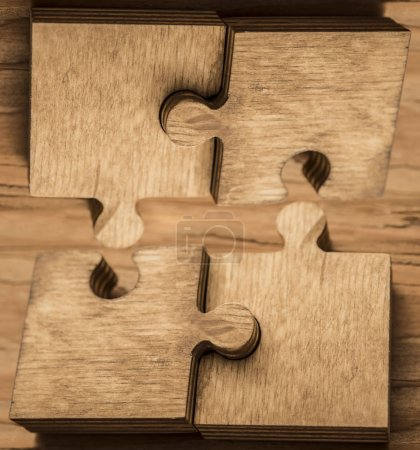 wooden puzzle pieces. concept of connection people